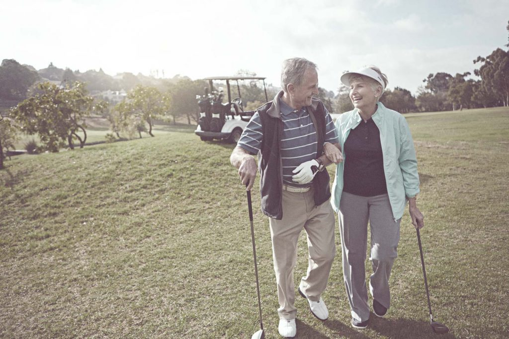 Retired Couple Playing Golf | Higginbotham Financial