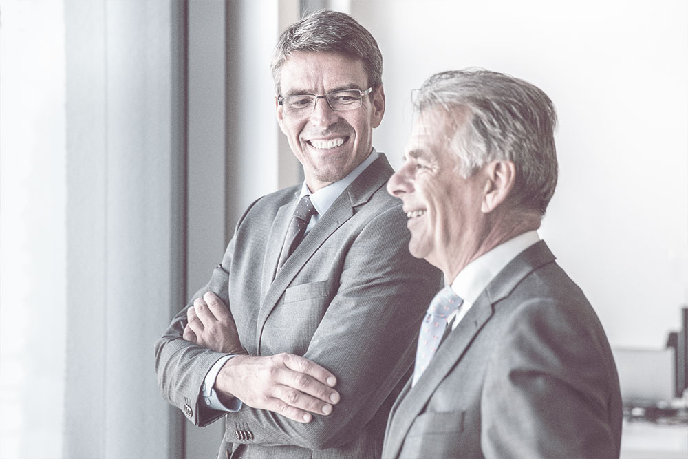 Executives talking | Higginbotham Financial